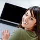 Fotolia_17763099_S.jpg (Attractive young female using a laptop)